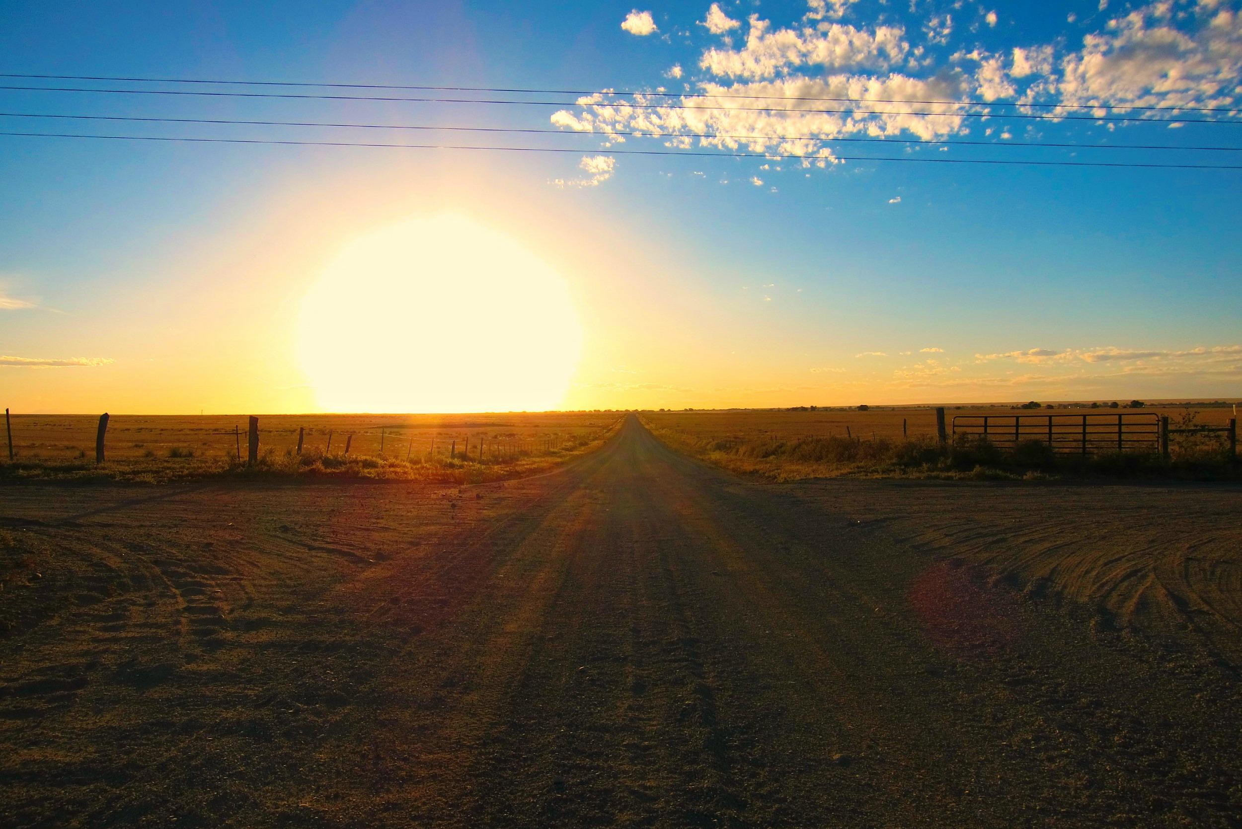 Sunset on gravel road resized.jpg