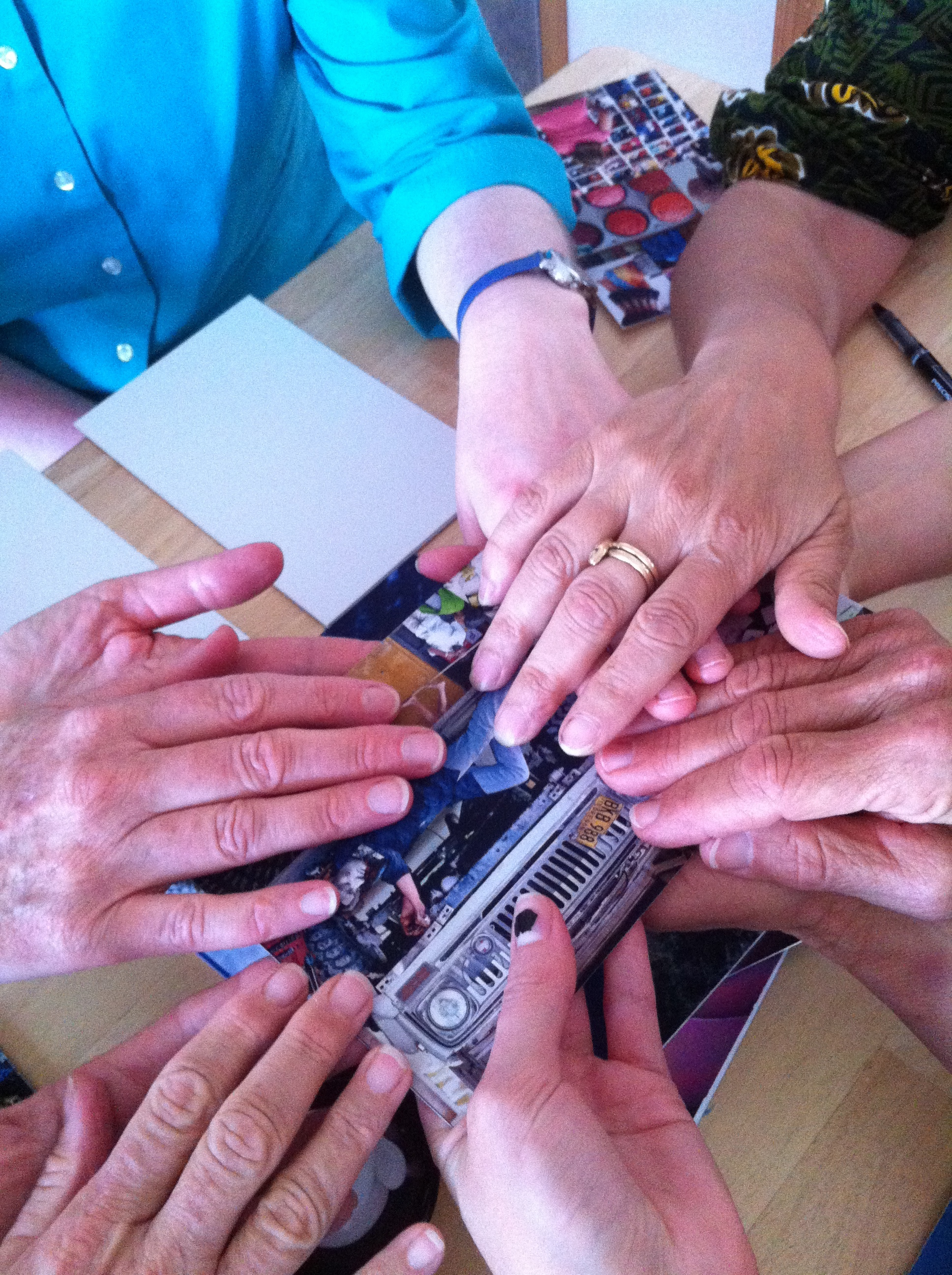 After the card speaks, the group holds hands with gratitude.
