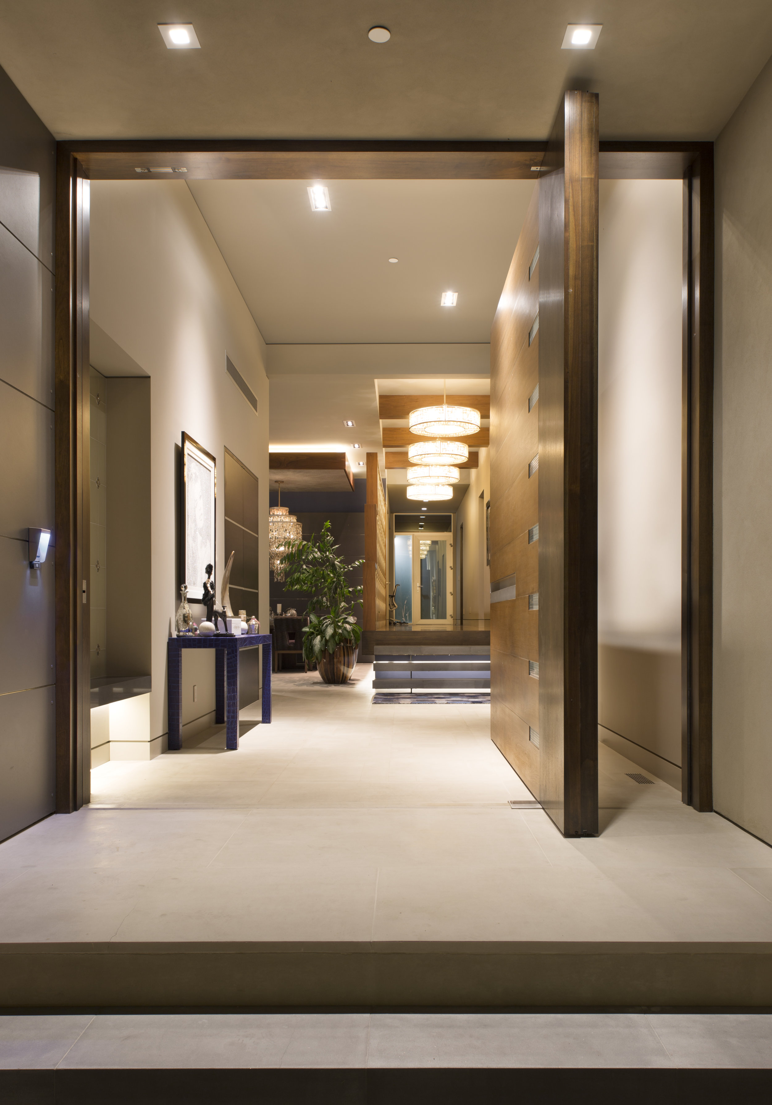 custom wood pivot entry door, fuse architecture russell simpkins photography