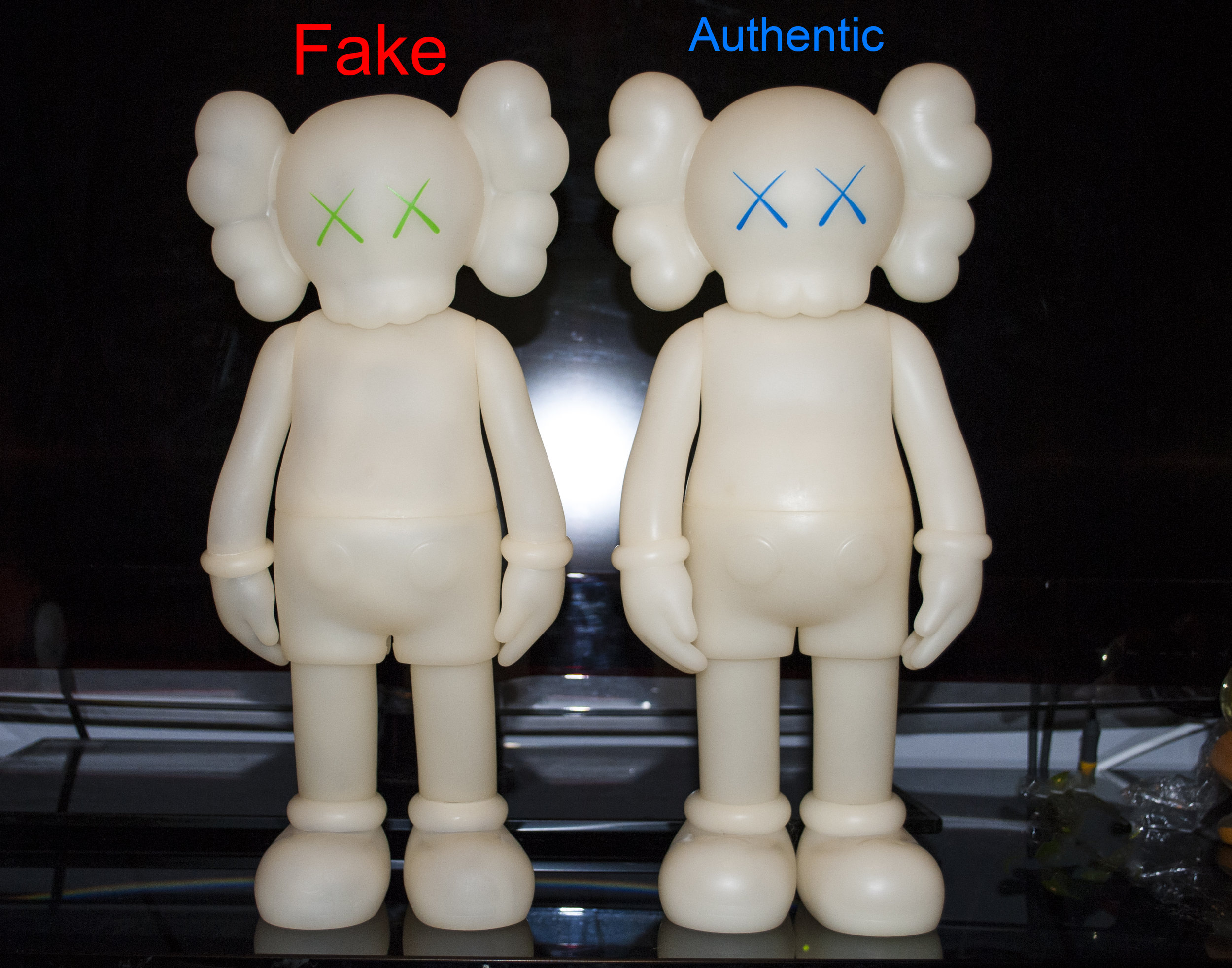 Notice the size. the Fake is slightly smaller and a little crooked. Also the quality of vinyl is slightly transparent compared to the authentic version.