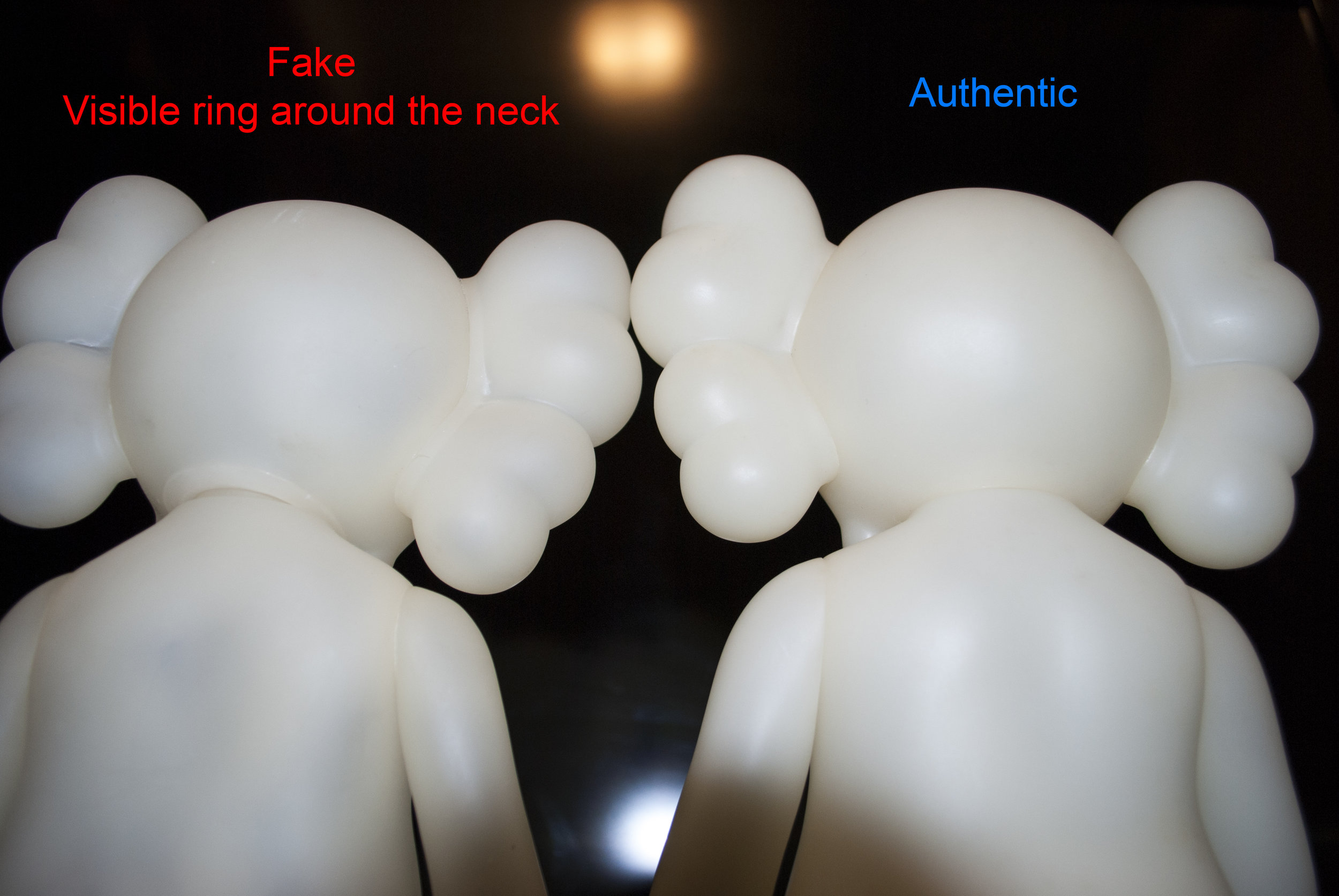 There is a clearly visible ring around the fakes neck. The authentic version is smooth