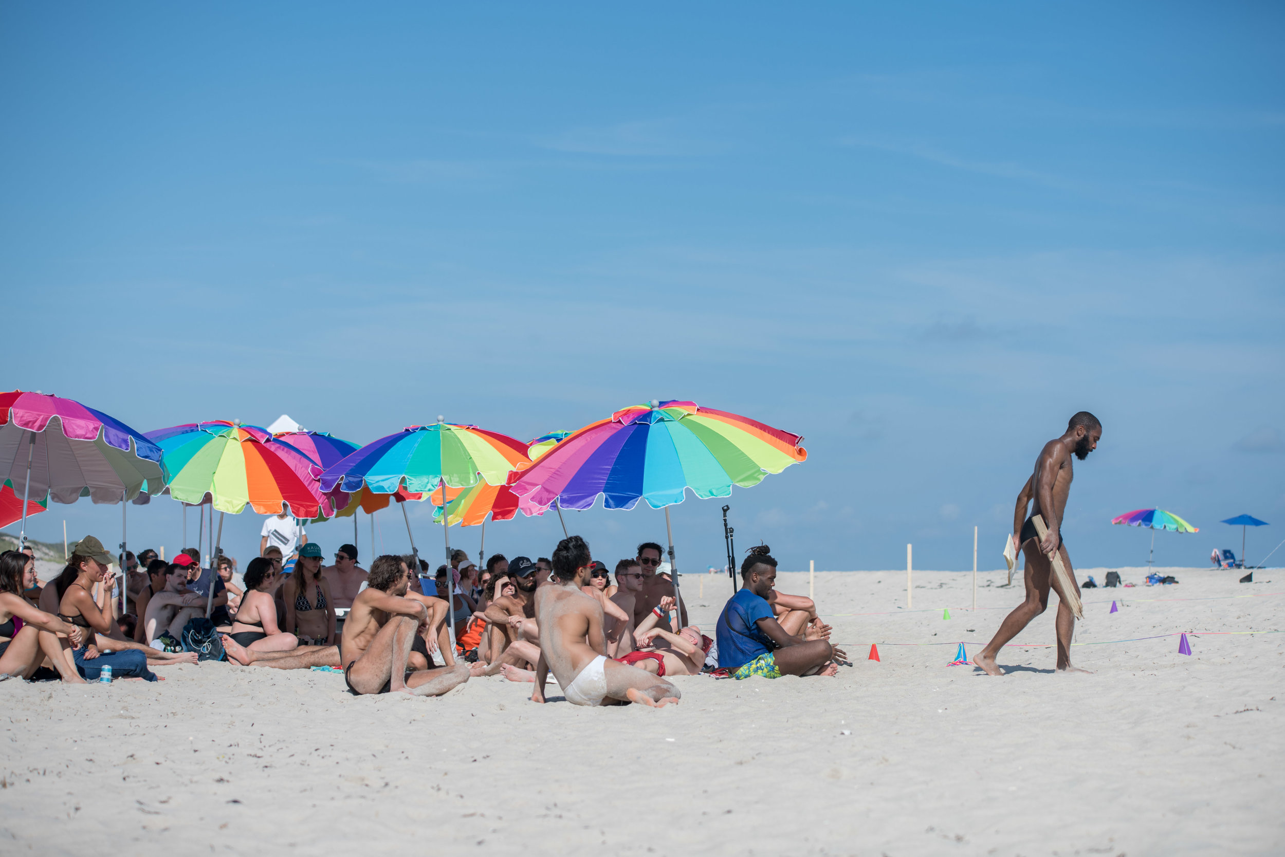 I walk away from the audience, who is seated under the arrangement of colorful beach towels. Photo by Nir Arieli