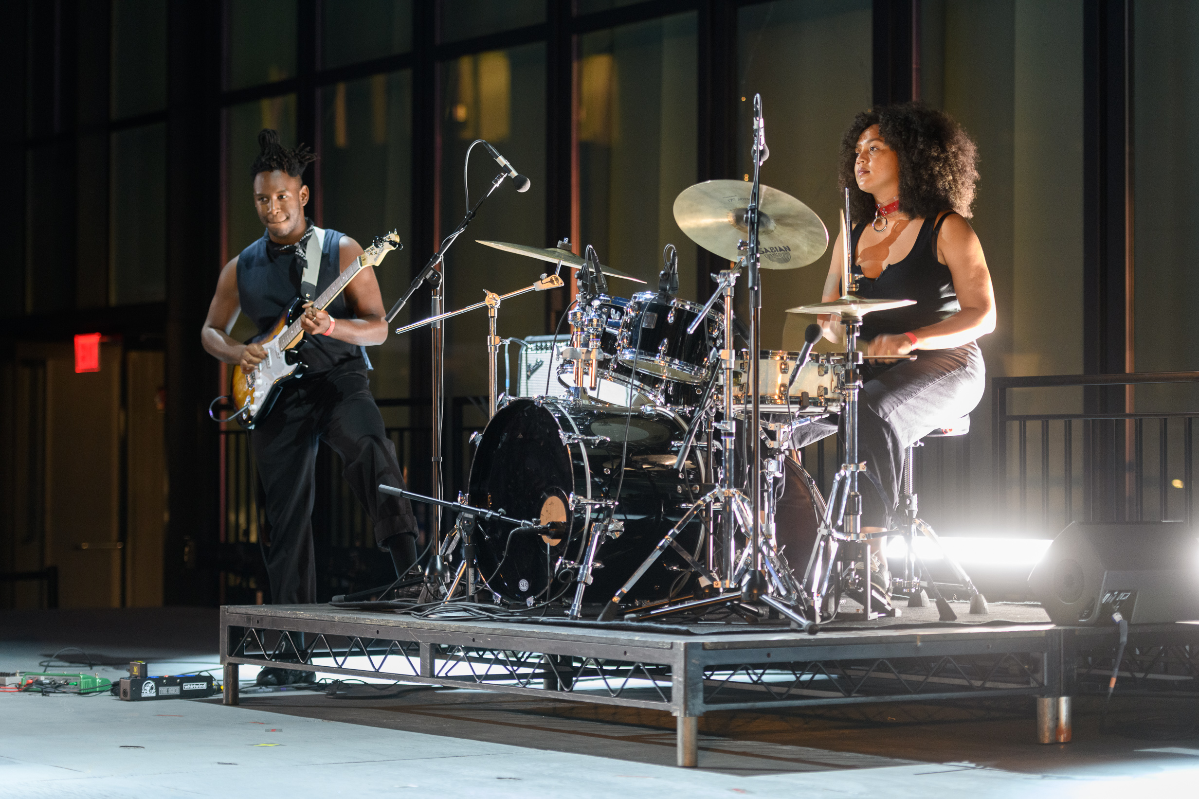 The guitarist, Sean, and drummer, Savannah on stage.