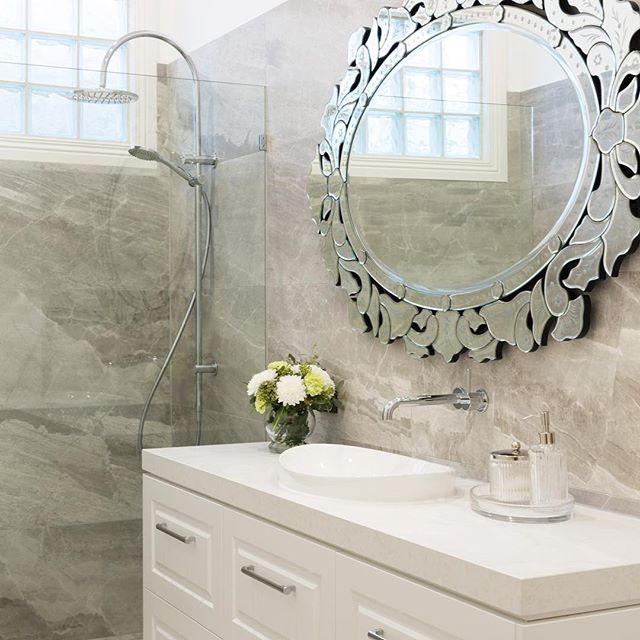 A feature mirror like this intricate one used in our recent Hawthorn bathroom renovation is a great way to inject some personality into your home . . . #bathroomrenovation #bathroomsofinstagram #bathroommirror #mirror #vanity  #interiordesign #interiordesignmelbourne #bathroomdesign #stone #tiles