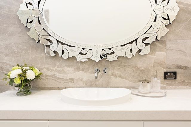 Classic and contemporary 📸 @elizabethschiavello . . . #bathroomrenovation #bathroom #bathroommirror #mirror #tiles #stone #flowers #vanity #interiordesign #faucetstrommen #reecebathrooms
