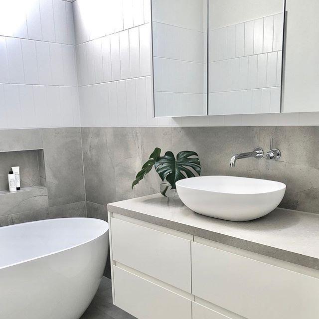 Subtle contrasting tile patterns in this bathroom ✔️ . . . #bathroom #bathroomdesign #bathroomrenovation #interiordesign #interiors #style #grey #white #tilepatterns #vanity #basin #bath #melbourneinteriordesign #melbourneinteriordesigner #plants @faucetstrommen #quantumquartz #faucetstrommen #salusbody