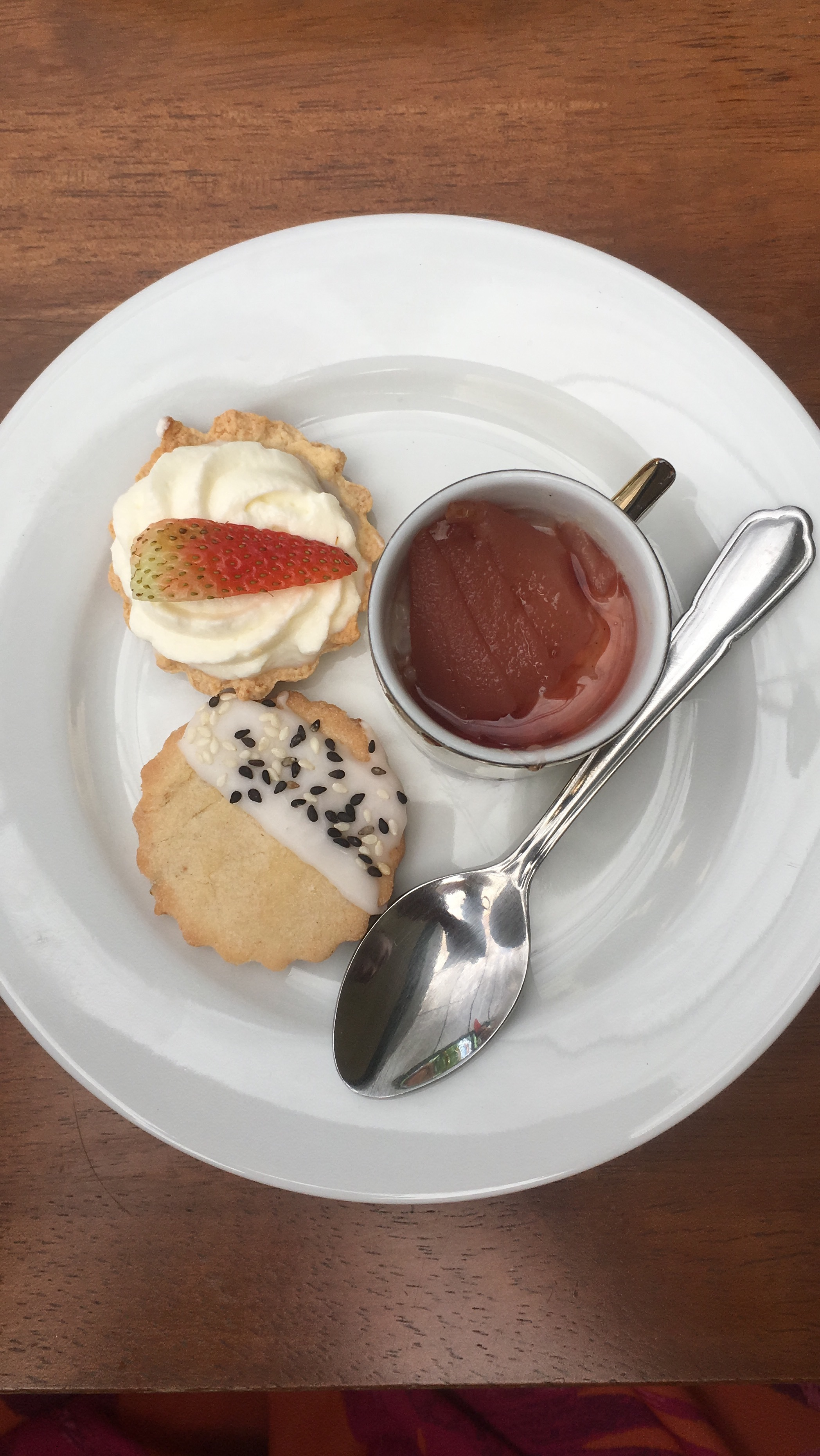 My delicious dessert plate: Spiced cookie, Chocolate mousse tarts topped with fresh strawberries and rice pudding with poached pears in white wine and cardamom.