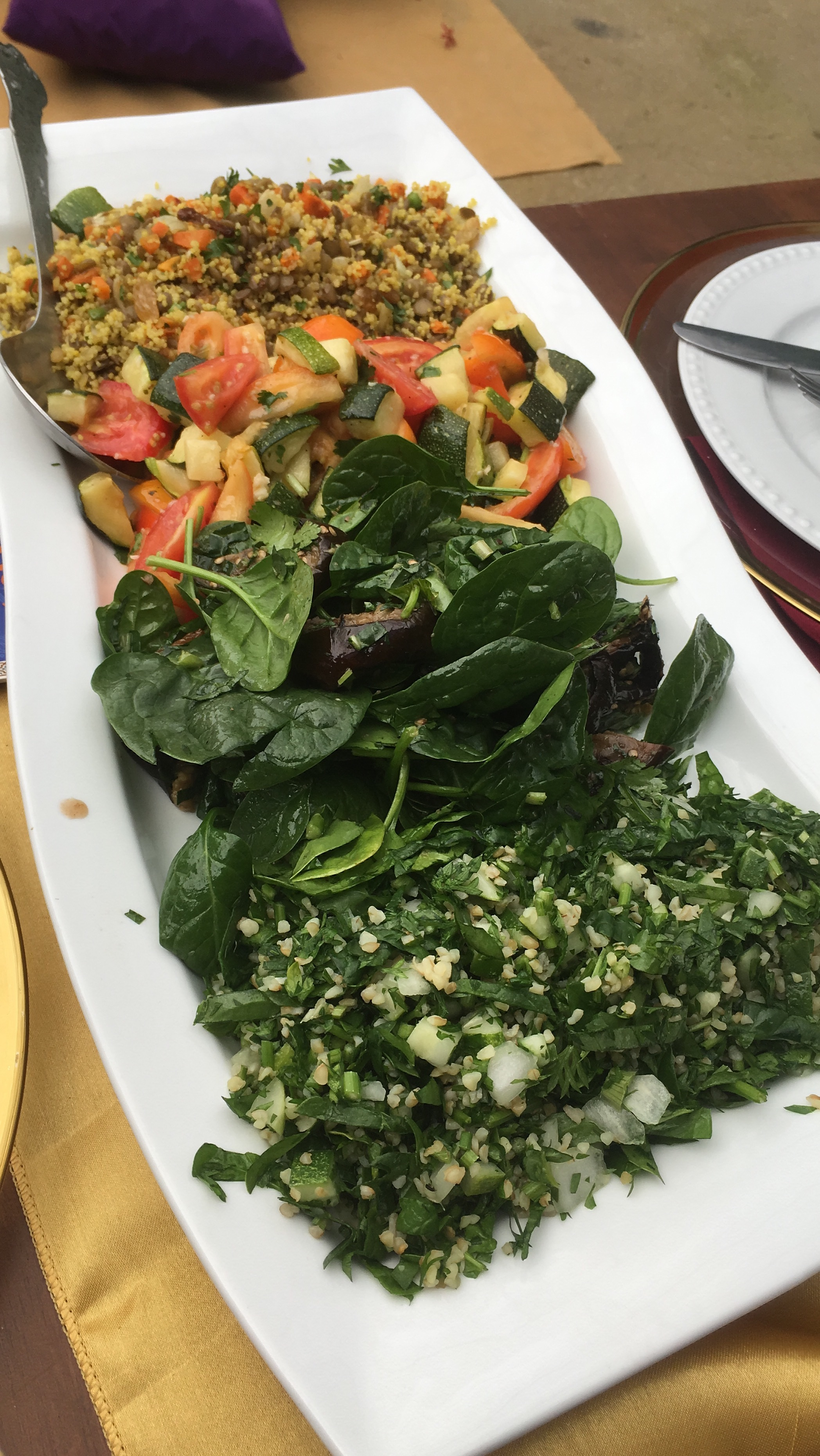 Roast beetroot salad with greens, couscous salad, grilled eggplant salad with hummus and Tabbouleh