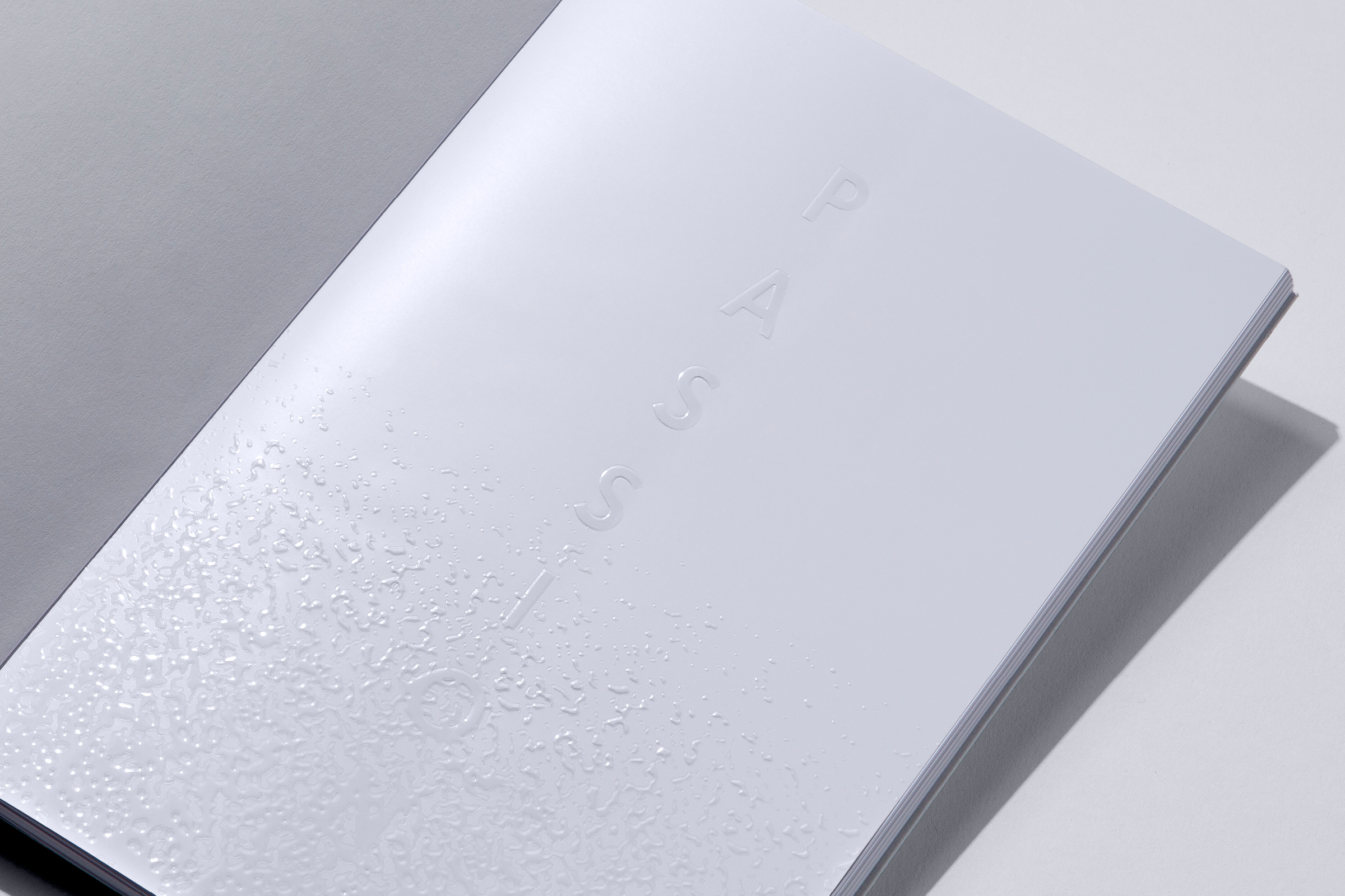 PASSION –INTRODUCTION  Clear foil and emboss on Silk-HD Matt 150 gsm.