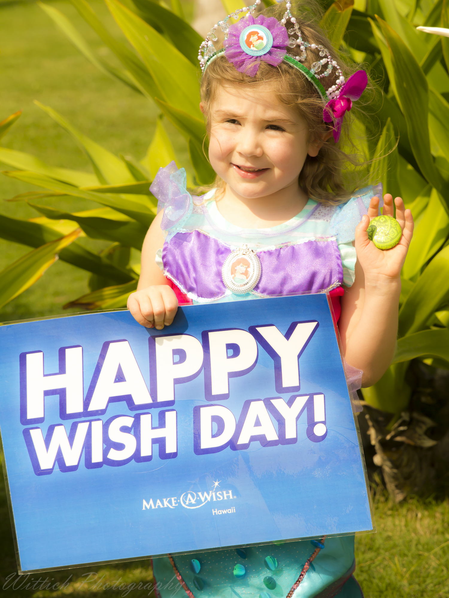 """- When given a chance to have her one true wish, this little one wished to be Ariel and go to Hawaii and meet Moana, to help Moana restore the Heart of Te Fiti! She talked about exploring the island by land, sea and air in search for the Heart. Through an incredible partnership, Make-A-Wish Illinois and Make-A-Wish Hawaii made the magic happen! From the highest level of attention and service every place we went, to a fun scavenger hunt of """"clues"""" leading our wisher to Moana and the Heart of Te Fiti, every detail was considered. On """"wish day""""—Allison and her little brother sailed across """"the sea"""" with Moana and a kind captain, and then finished their adventure by playing hide and seek with the Heart of Te Fiti. The utter joy in their hearts was apparent and is hopefully something you can even a glimmer of through these photos. Click the links at the top of this page to donate to Make-A-Wish Foundation and help make another child's one true wish come true!"""