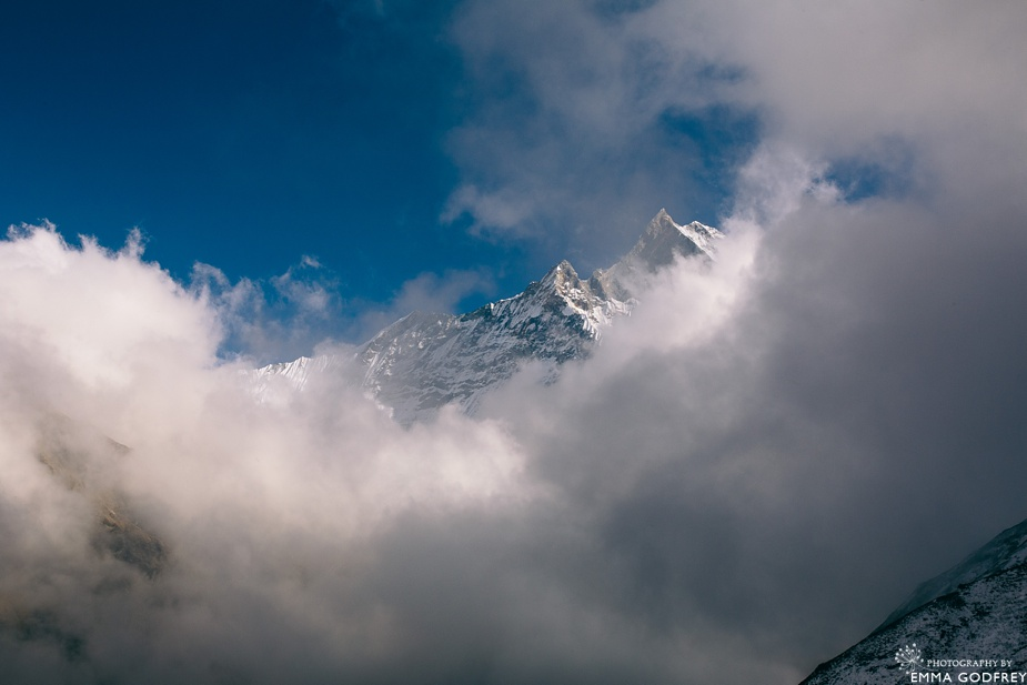 Machapuchare peeks through the clouds