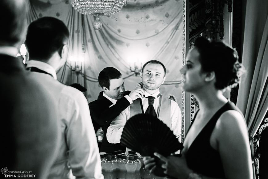 Bestman fixes groom's tie in the mirror of the Palais Eynard