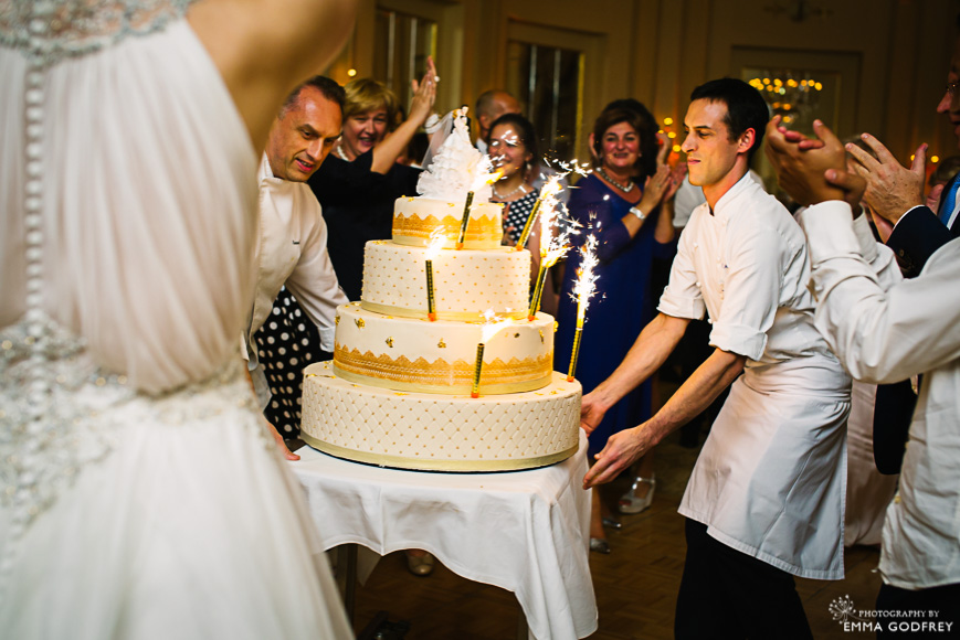 Wedding cake entrance with large sparklers