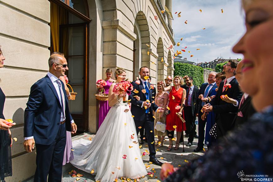 Rose petal wedding exit at the Palais Eynard