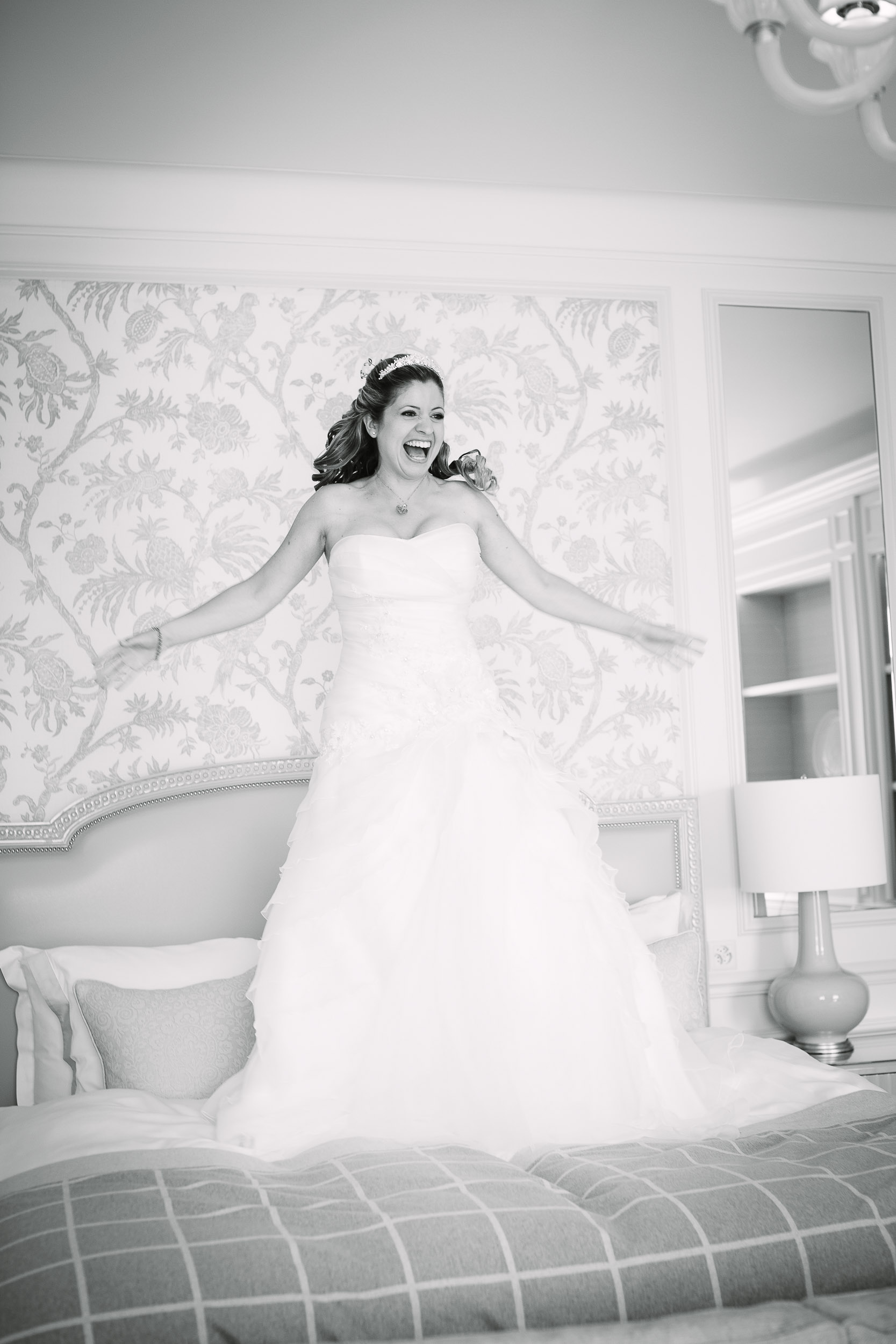 Wedding preparation photo bride jumping on bed