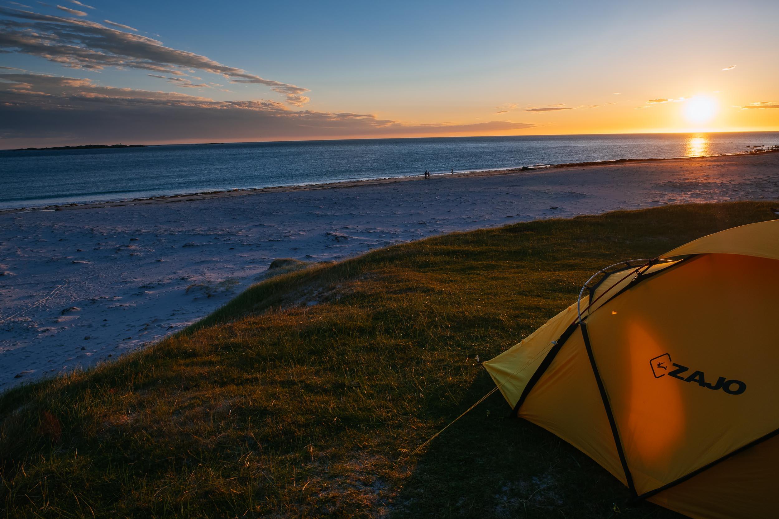 Camping under the midnight sun in Lofoten, Norway.