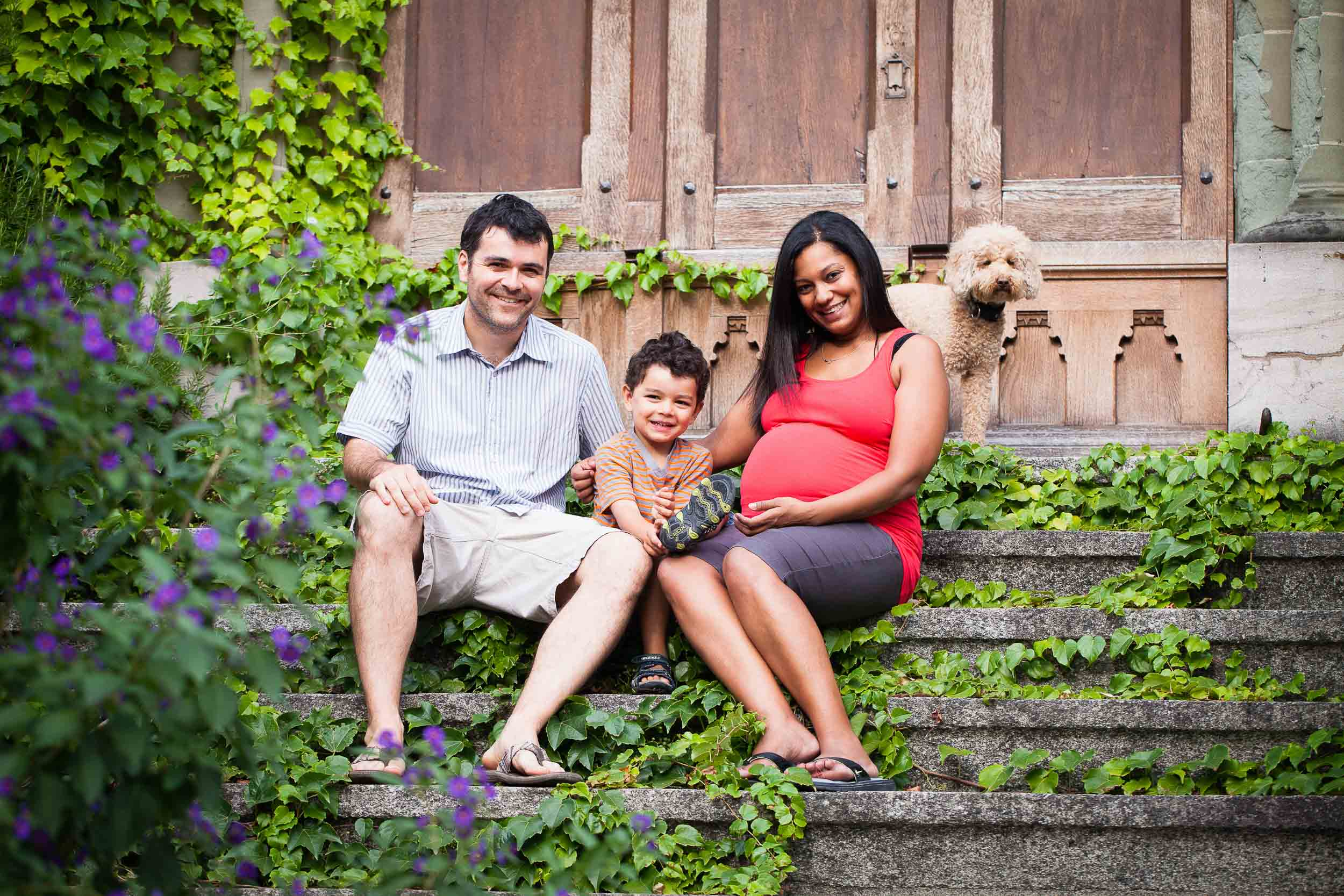 The whole family relaxes on the steps of Cully church for some natural maternity photos