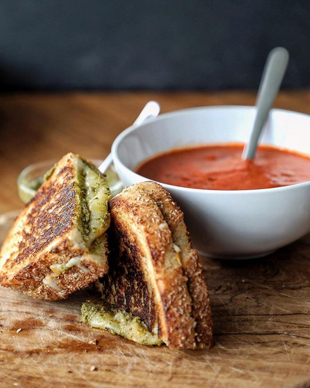 Roasted Tomato and Red Pepper Soup with Pesto Grilled Cheese - the perfect lunch on a grey day! . #tomatosoup #tomatoandredpeppersoup #grilledcheese #pesto #cheese #lunch #meatfreemonday #meatlessmonday #foodphotography #foodstyling #foodblogger #hkfoodblogger #feedfeed @thefeedfeed #f52grams #thekitchn #hautecuisines #beautifulcuisines #heresmyfood #gloobyfood #bbcgoodfood #foodieflatlays #mylittlehongkongkitchen #huffposttaste #foodandwine #saveurmag #lifeandthyme #mycommontable #foodieflatlays #bonappetit #saveurmag #eeeeeats #pinkladysnapsmar19
