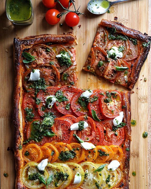 After seeing so many yummy 'ombré' style tomato tarts and galettes I thought I'd try my own. This is my Rainbow Tomato Tart with Red Pesto, Soft Goats Cheese and Basil Oil. The perfect late summer lunch and so easy to put together. This recipe will be featured in my regular column in @afoodieworld next month so keep your eyes peeled! . #tomatotart #heritagetomatoes #ombretart #tomatoes #vegetarian #meatlessmonday #meatfreemonday #afoodieworld #foodwriter #foodphotography #foodstyling #foodblogger #hkfoodblogger #feedfeed #f52grams #thekitchn #hautecuisines #beautifulcuisines #gloobyfood #bbcgoodfood #foodieflatlays #mylittlehongkongkitchen #huffposttaste #foodandwine #saveurmag #lifeandthyme #mycommontable #bonappetit #saveurmag #pinkladysnapsaug19
