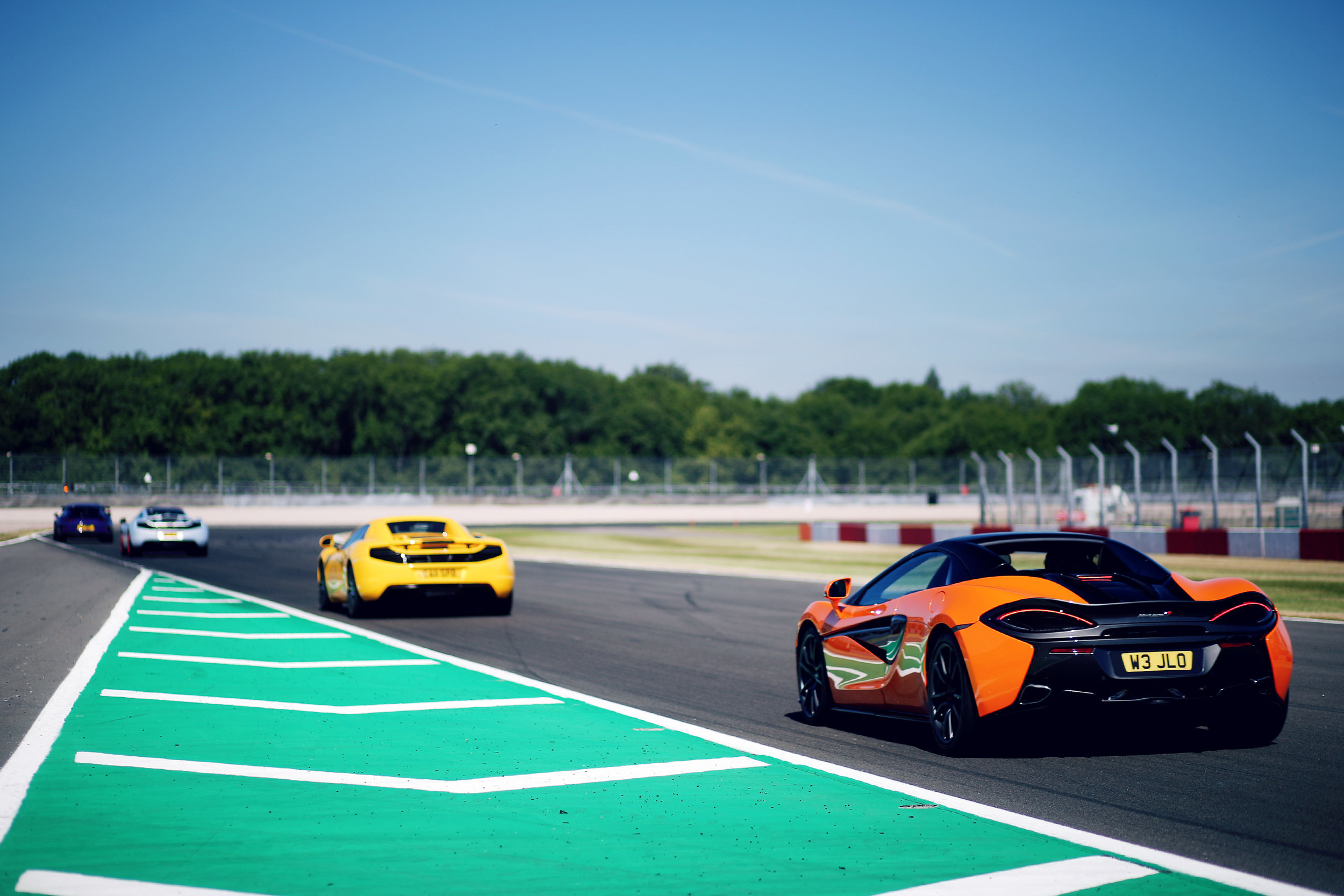 Four supercars taking on Redgate Corner at our 2018 Donington Park Greystone GT trackday