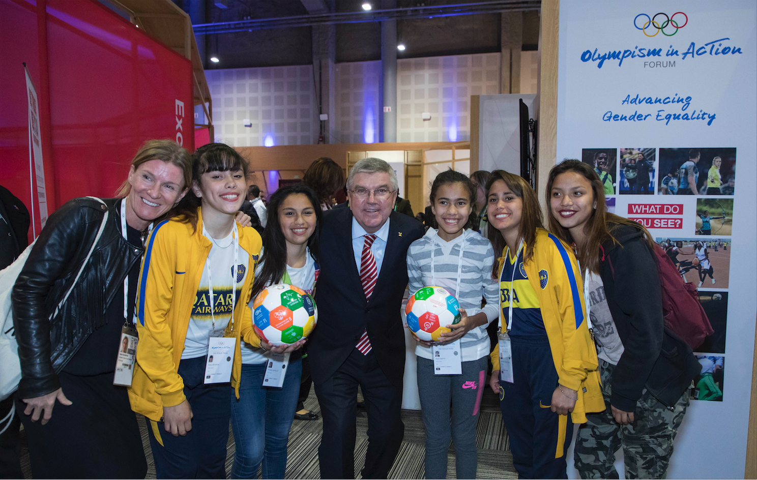 League players and IOC president Thomas Bach