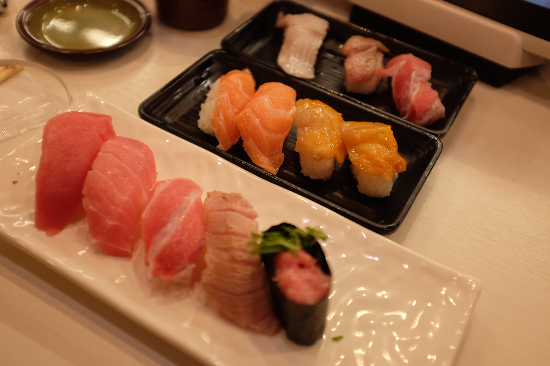 Goodies from a rotating sushi bar in Kyoto. Many different grades and cuts of tuna nigiri for a very affordable price.