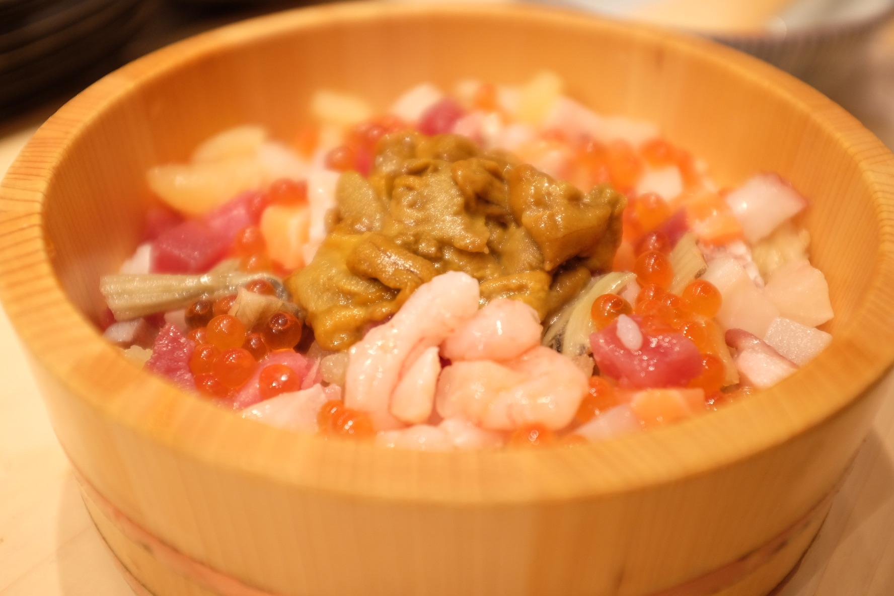 """Sea Urchin, salmon, tuna, yellow tail, salmon roe"" Don. We found it at a small bar in Tsukiji Market, Tokyo."