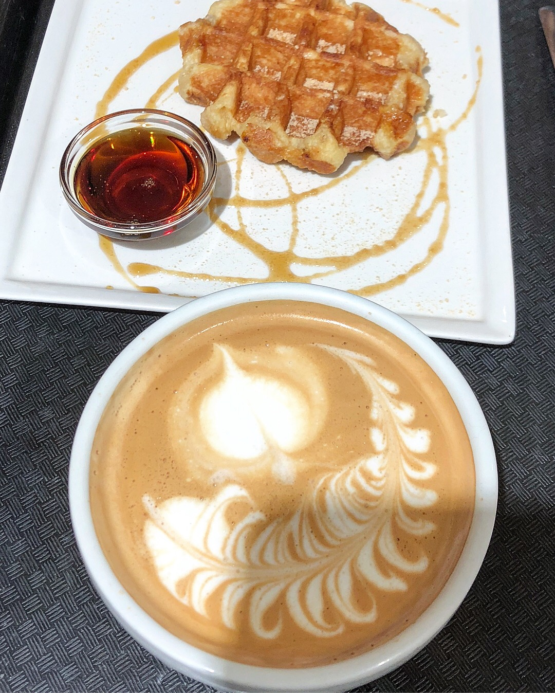 So maple syrup alone, has so many varieties. All shades of colours, consistencies, and different maple syrup products. This right here is waffle with maple drizzle and maple latte.