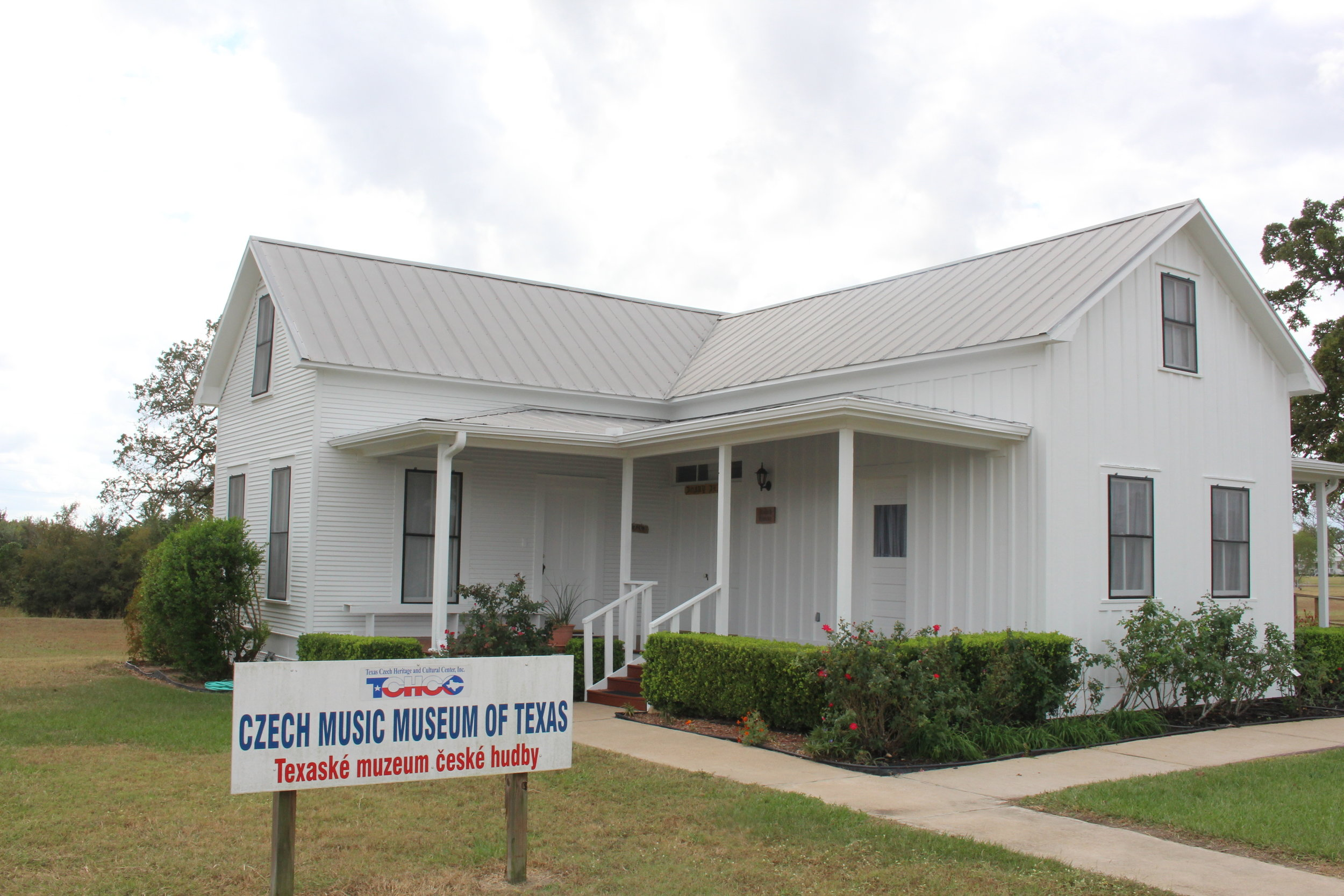Development of TCHCC began when the Kalich House, restored by volunteers, became the first TCHCC Visitors' Center. This historic 1890s Texas-Czech farmhouse was donated by Peggy Kalich of Schulenburg. The house was moved to the site on June 22, 2000 by Káňa Brothers, Inc. House Leveling and Moving and then transformed into the Visitors' Center, which temporarily housed the office, gift shop, library, and display area.  The restoration efforts took approximately 3,109 hours with some 80 volunteers ranging in age from 2 to 80. Major restoration of the roof and porches was done by Robert Slovak Construction and volunteers from Ennis. It served as the Visitors' Center until 2009 when the main building was completed.  It is now TCHCC's Czech Music Museum of Texas displaying music memorabilia in four musical genres: Classical Music of Czech Composers, Spiritual/Liturgical Music, Folk Music and Dance, and Polka/Czech Brass Music.