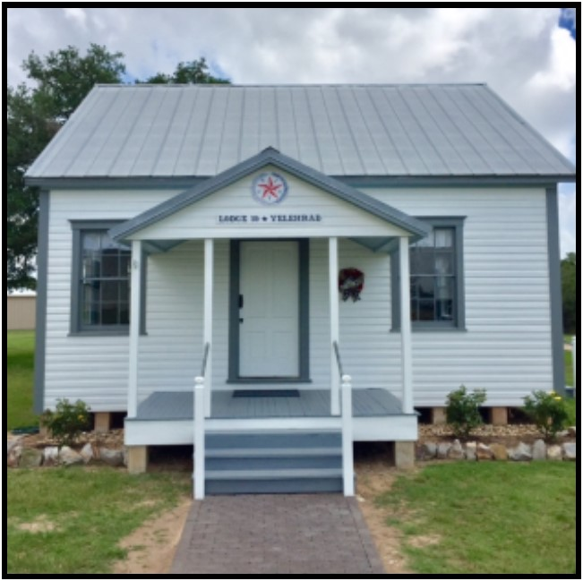 The Lodge was moved from its original site in northern Lavaca County in the Velehrad community to TCHCC on Novemnber 9, 2017 by Káňa Brothers, Inc. Beginning in the spring of 2018, SPJST Foundation directors started making repairs. By the end of 2018, the building was ready to be painted both inside and out, including sanding and refurbishing the longleaf pine floor. Efforts were made with the selection of paint colors and the refurbishing of the furniture to match the original condition much as it would have appeared in the summer of 1897 when SPJST ( Slovanská Podporující Jednota Státu Texas ) was established and Lodge #19, Velehrad received its charter as one of SPJST's first 25 charter lodges. The Grand Re-Opening of the Lodge at TCHCC was held on May 19, 2019. This celebration represented the continuation of the restoration efforts which commenced in 2002. In the spring of 2006, the exterior of the building was restored by members of the SPJST District 6 Cemetery Association. All three of these efforts contributed to rescuing this historic hall from obscurity.  Read more .