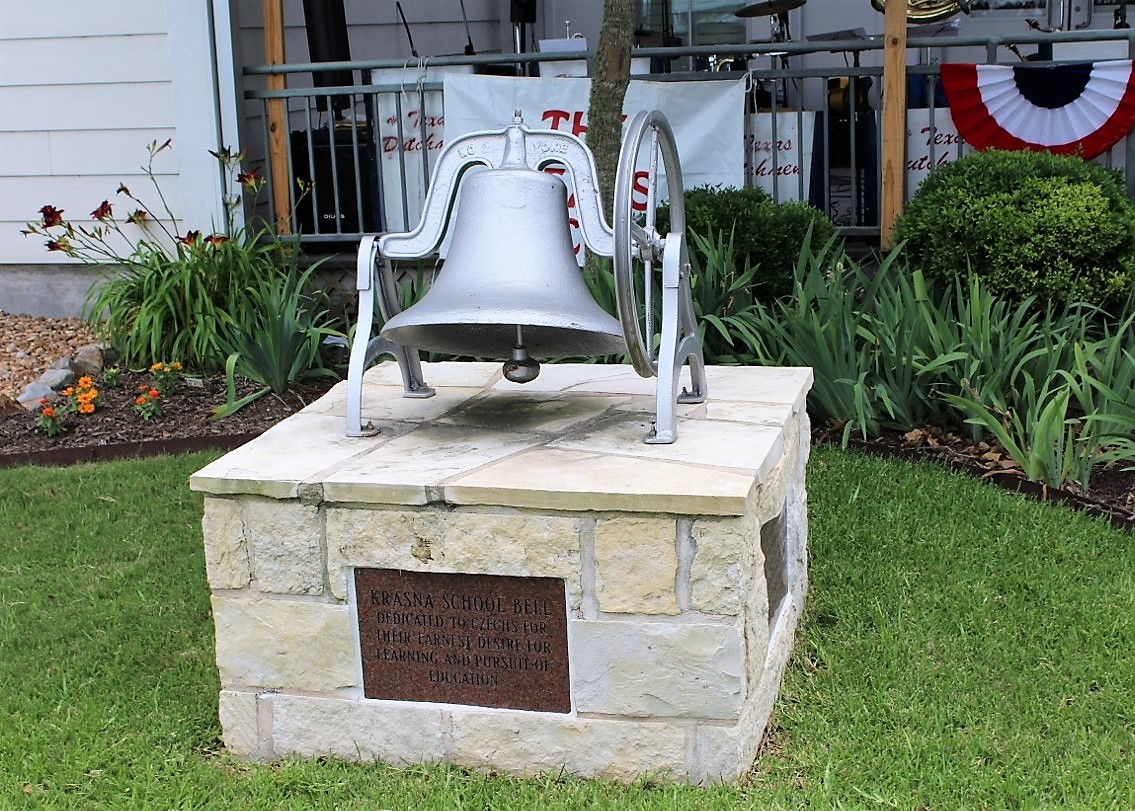 DEDICATED TO CZECHS FOR THEIR EARNEST DESIRE FOR LEARNING AND PURSUIT OF EDUCATION BELL DONATED BY HONORARY CONSUL GENERAL RAYMOND SNOKHOUS AND CLARICE MARIK SNOKHOUS 2014  In 1891, Francis Smith subdivided and sold property in the Wallis area. In 1892, he gave four acres for a school and church for Czech settlers forming the community of Krasna, which means beautiful in the Czech language. That year, local families built a school, and in 1893, it became part of Orchard Common School District. By 1894, it was part of the Krasna District, which included Connersville School for African American students. Two additional schools, Moravia and Central, were later built. Flooding and storms caused a decline of the settlement, and the Catholic Church at nearby Wallis (Austin County) attracted settlers; there was never a church at Krasna.  Read more .