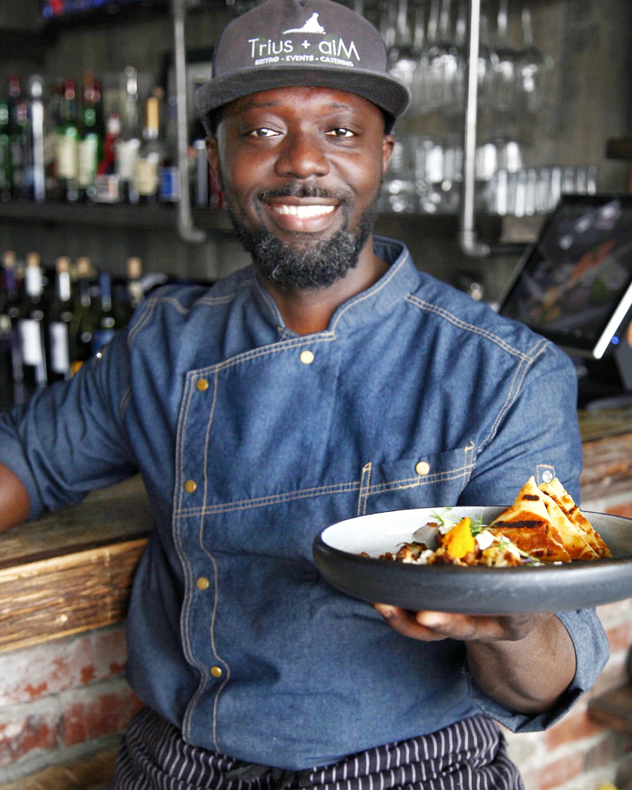Meet the Chef! - Chef Daniel AnsuPassionate. Authentic. Creative. Talented. Kind, Chef Daniel Ansu has over 15 years experience in some of Toronto's and Ottawa's high-end restaurants. Originally from Ghana, Africa, he enjoys combining bold flavours from around the world to create a unique menu. Most importantly, Chef Daniel is a proud father of three, who inspired the Trius + aiM endeavour.