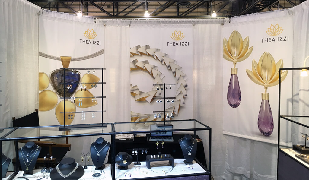 New graphics for Thea Izzi's booth.