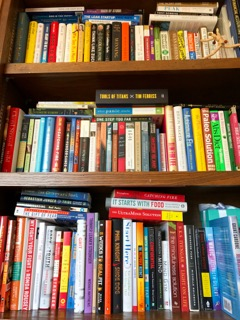 My overflowing bookshelf as of today. Note to self: must reorganize soon.
