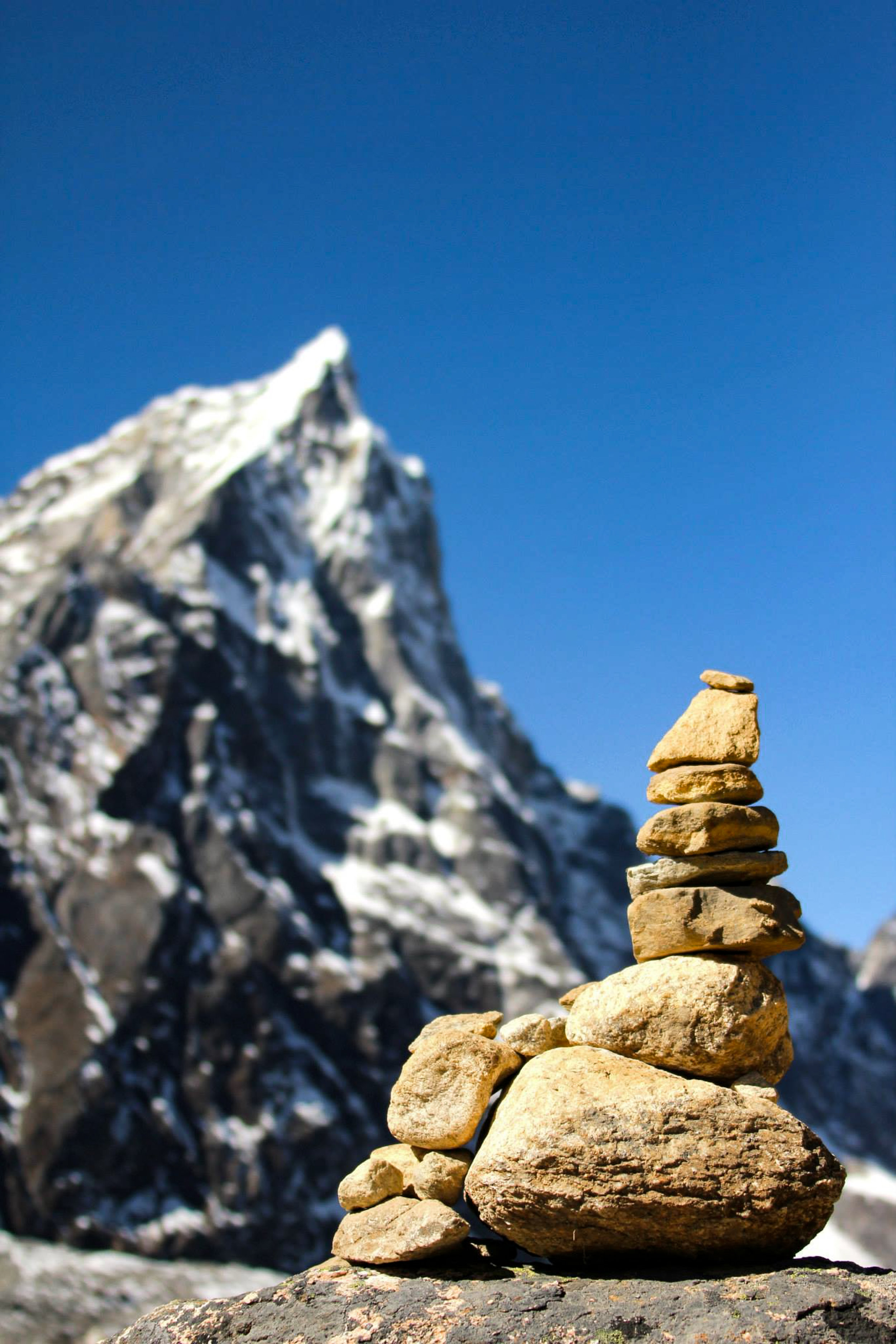 A stone cairn mimics the Himalayas on the trek to Everest Base Camp, Nepal