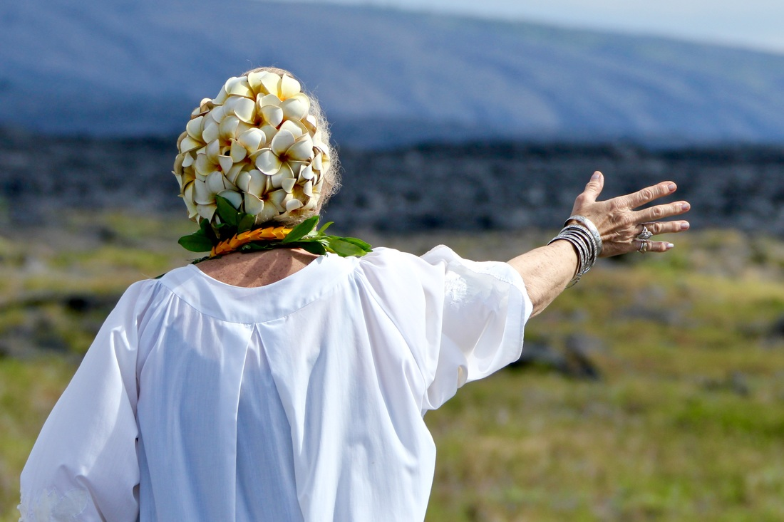 A Kahuna performs a blessing before road construction over old lava flows in Hawaii