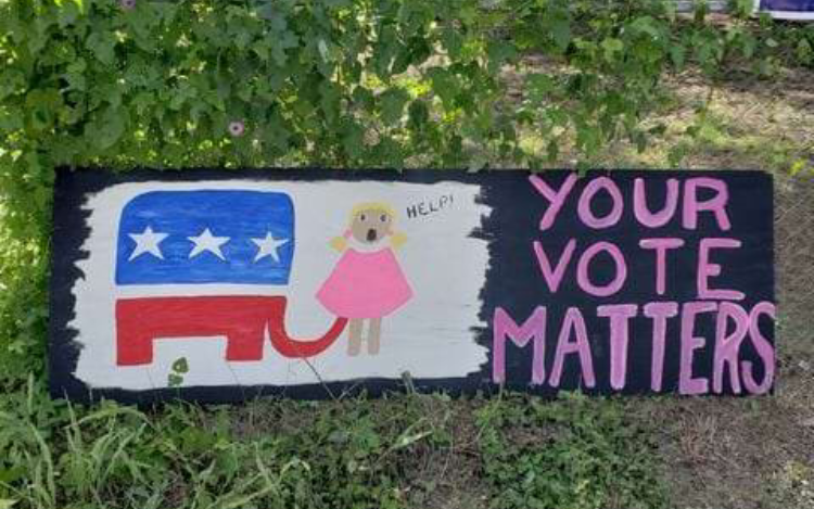 Sign by Marion Stanford.