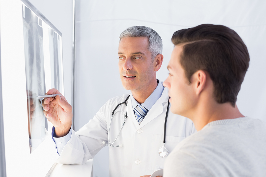 bigstock-Doctor-showing-X-rays-to-his-p-85570799.jpg
