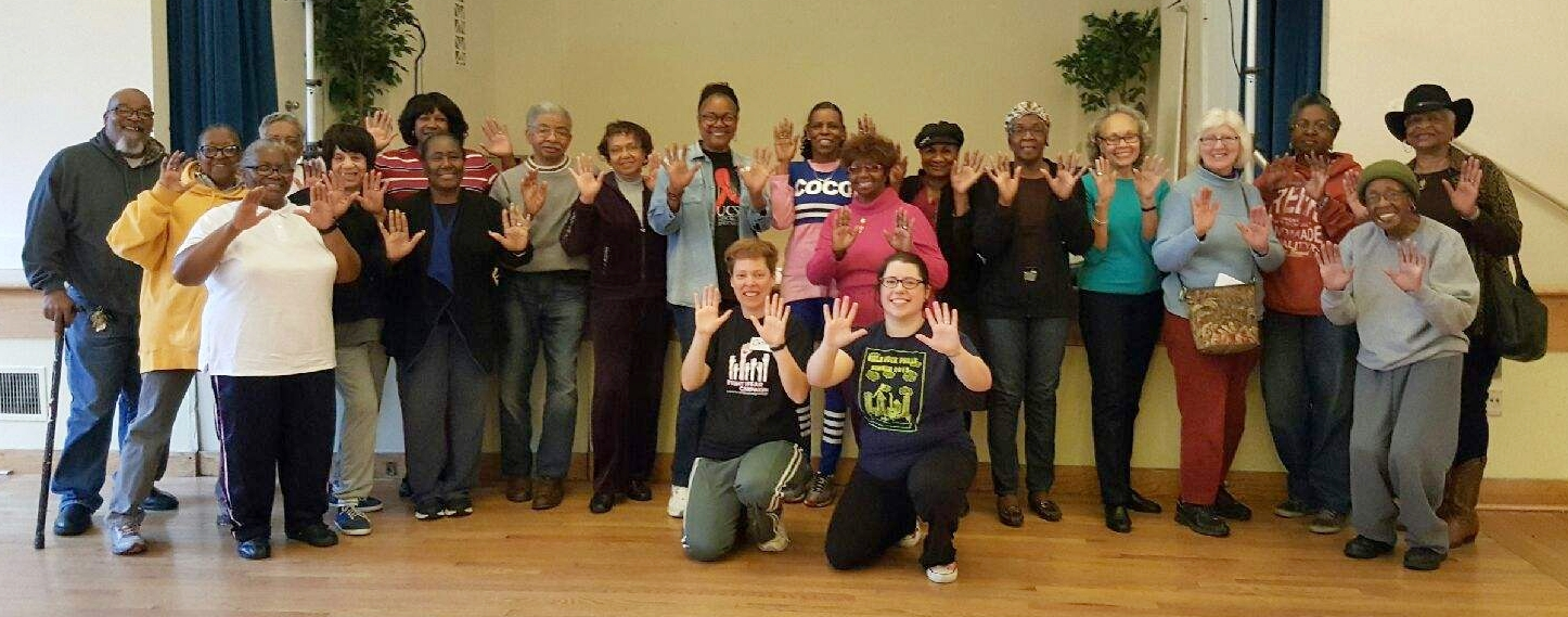 Seniors at Center in the Park pose for a picture after a WAVE workshop.