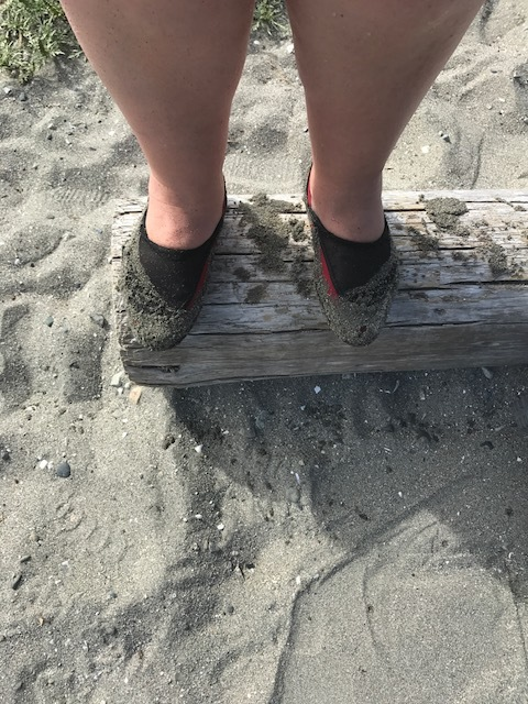 Red and black shoes quickly became so sandy that you couldn't tell what colour they were.