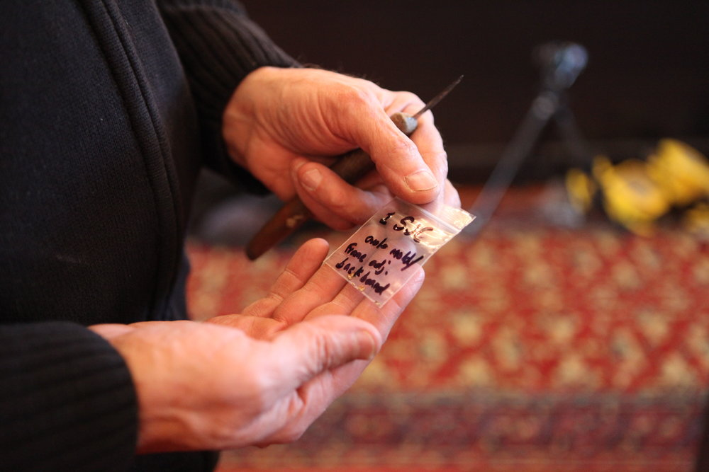 Howlett holds a sample collected from the sounding board.