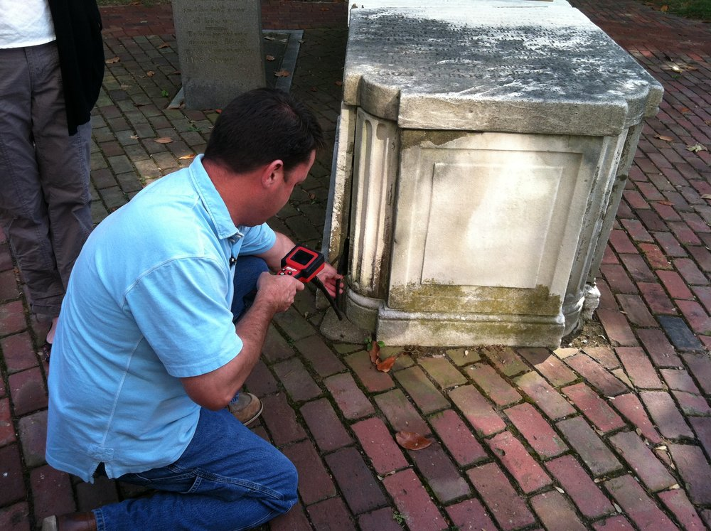 A camera is used to observe the interior of monument before disassembly.