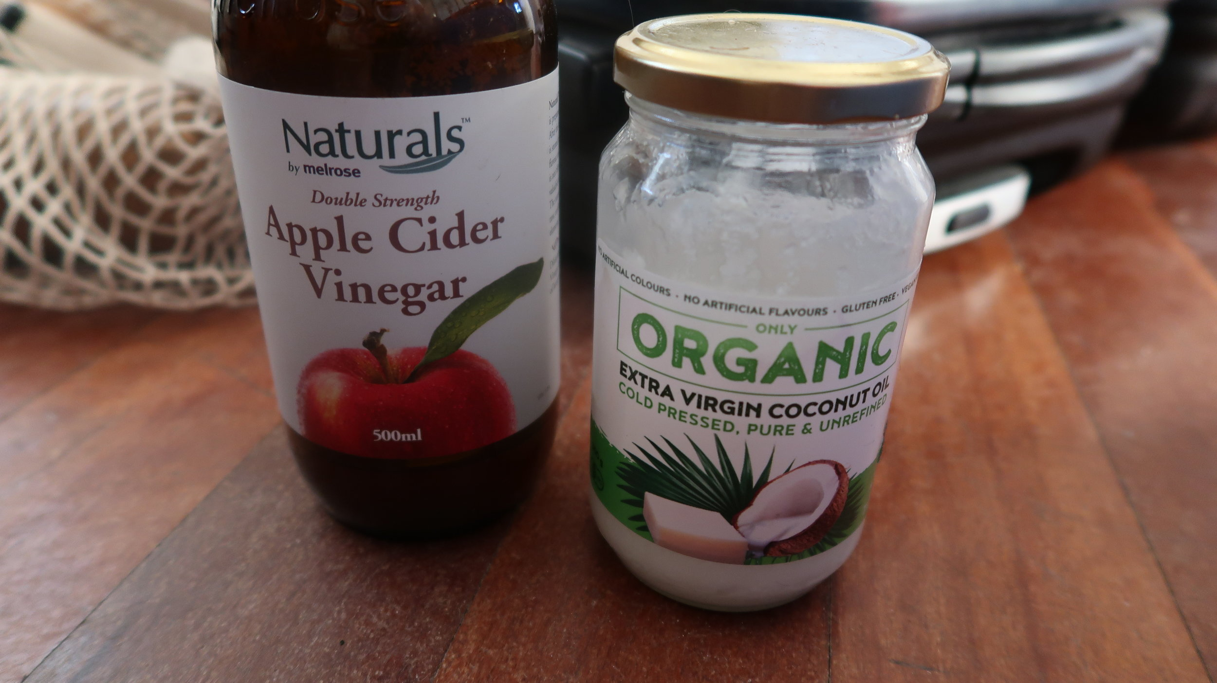 Two things I'm not packing in my bag to avoid leaks. Apple cider vinegar and coconut oil for my hair.