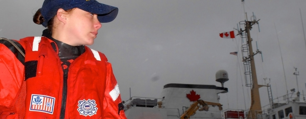 Seaman Elizabeth   Vannatta   stands look out aboard a 27-foot Response Boat-Small from Station Ketchikan as the 175-foot U.S. Coast Guard Cutter Anthony Petit and the Canadian Coast Guard Ship Bartlett crews conduct a vessel of opportunity skimming system deployment exercise in Refuge Cove five miles north of Ketchikan.