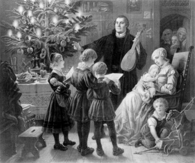 Luther singing around a Christmas tree. Because Christmas is important.