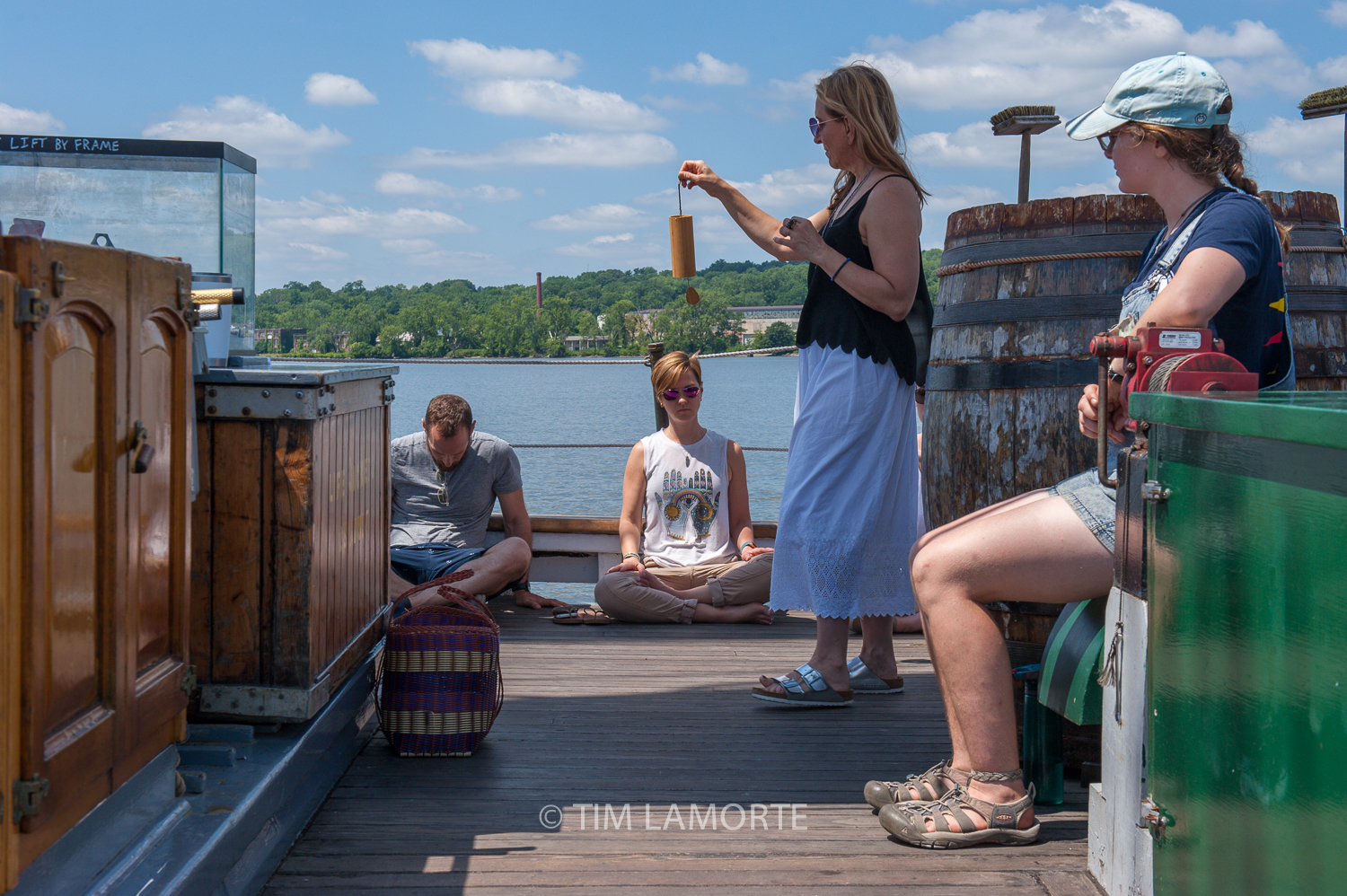 Jennifer Llewellyn sounds a chime as passengers Jon Werberg and Sarah Brunelle and Clearwater's engineer, Miranda Holmes, meditate.