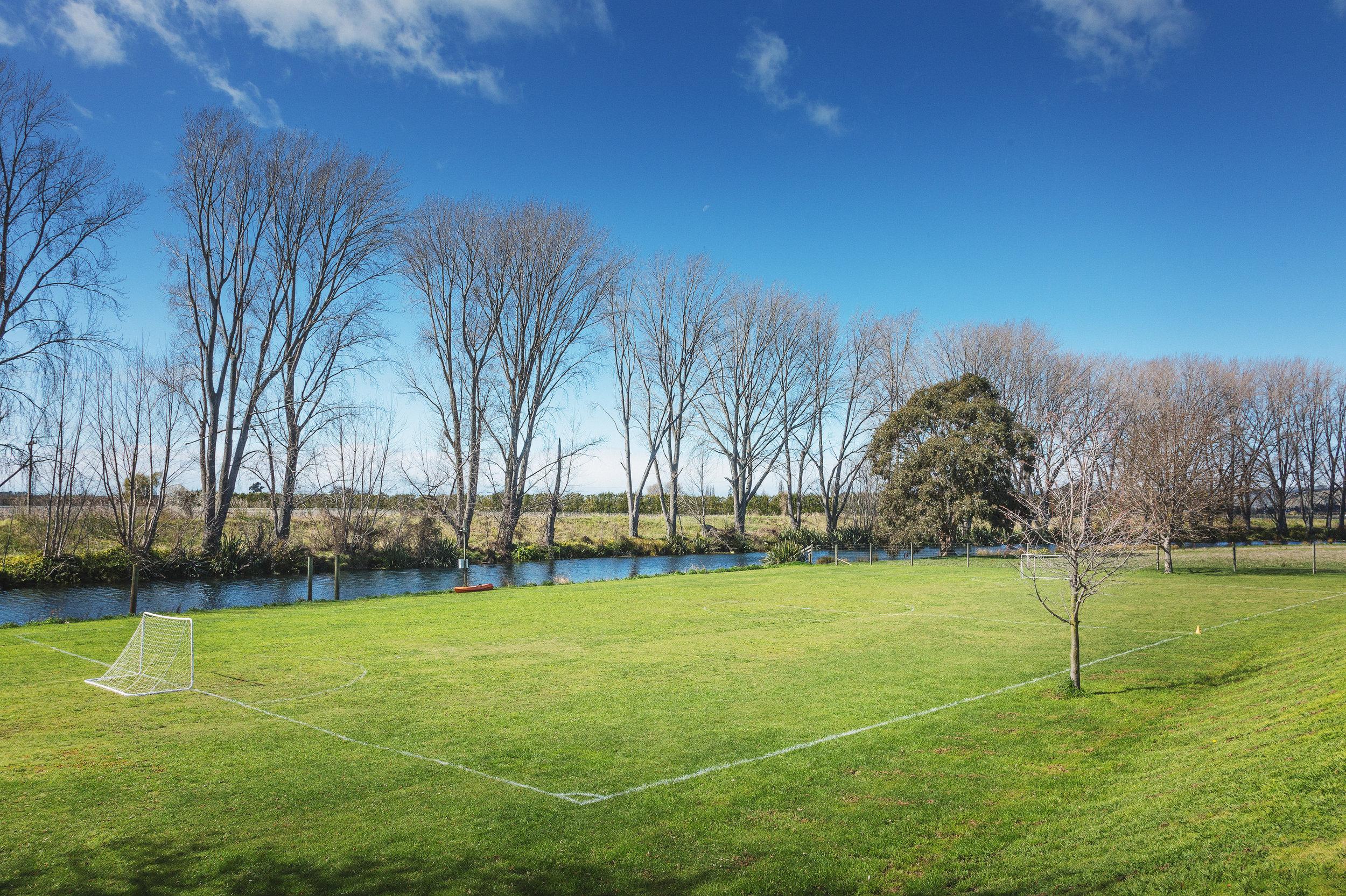 Recreational field alongside the Opawa River