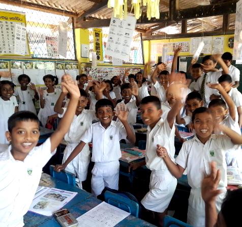 GapYear Kids waving in class.jpg