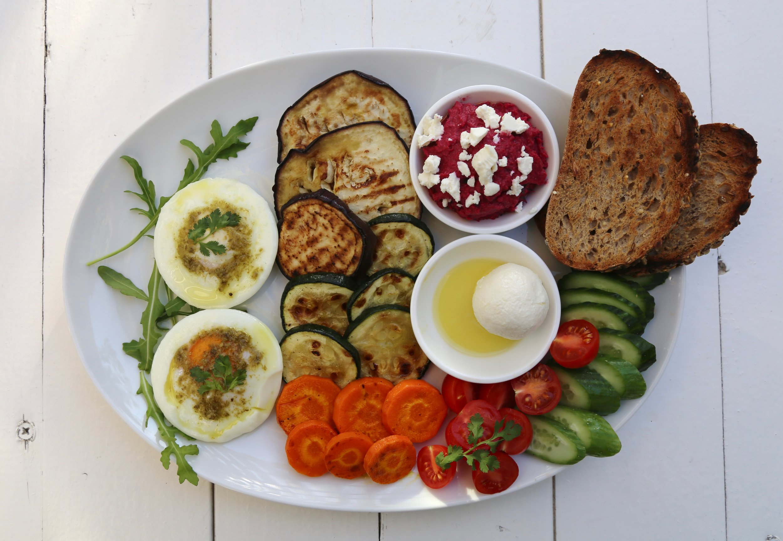 Breakfast Combo Meal: Served with labaneh, carrot, cucumber, hummus, grilled veggies and toast bread