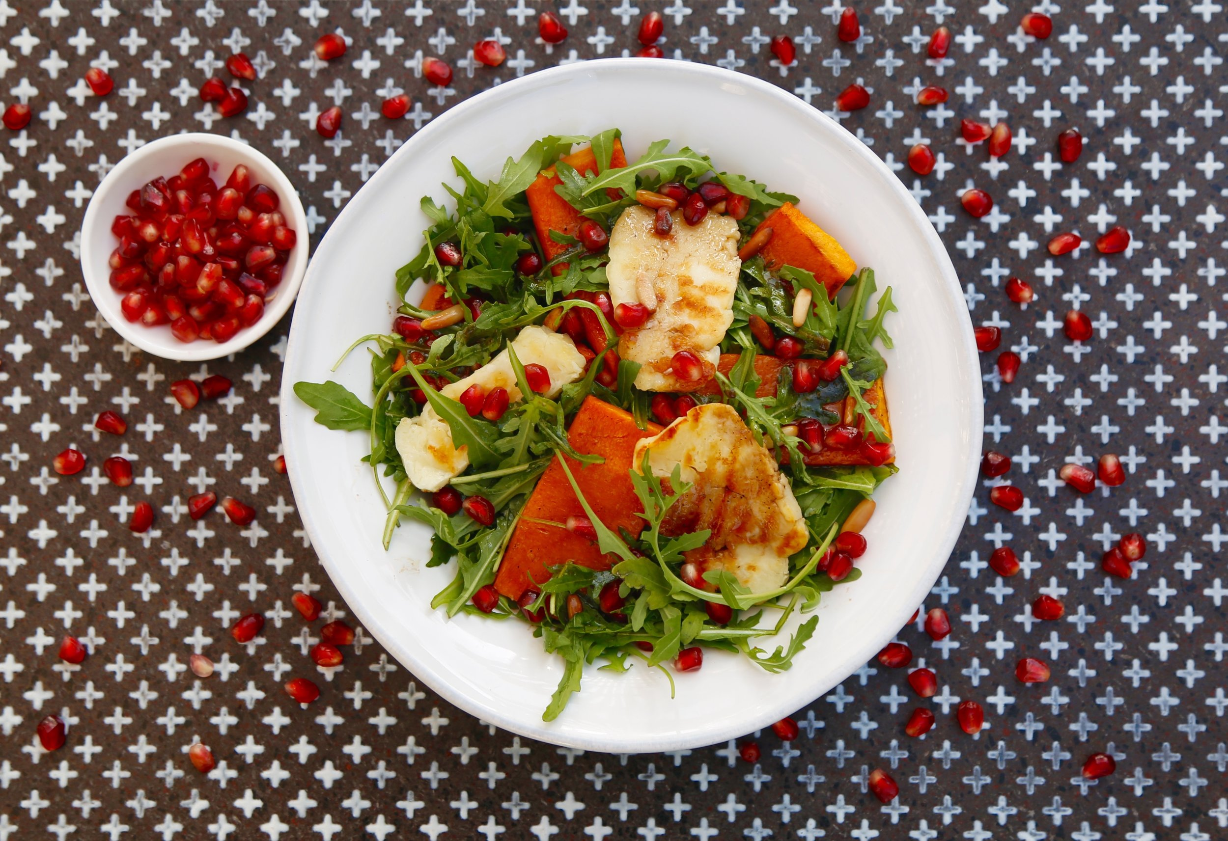 Rucola, Grilled Halloumi & Pumpkin Salad: Pomegranates,  pinenuts and balsamic dressing